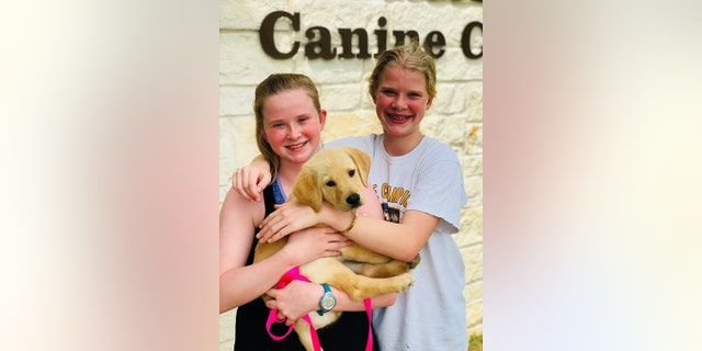 """The Texas mom was inspired to train a service dog so her daughters could """"experience giving back to the community"""" in a tangible way."""