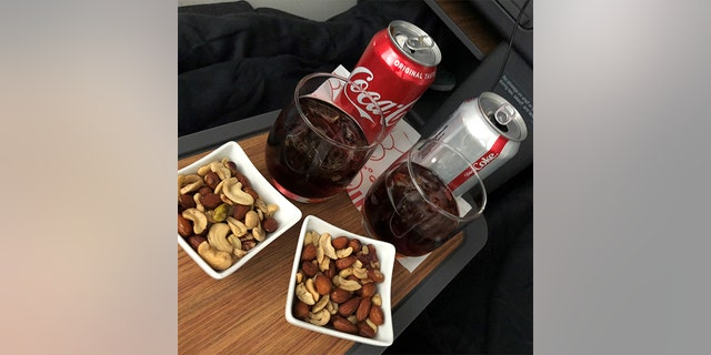 The drinks and nuts served on the American Airlines flight.