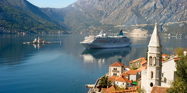 "Aerial view on town Perast with Church ""Our Lady of the rocks"" and cruise liner. Montenegro"