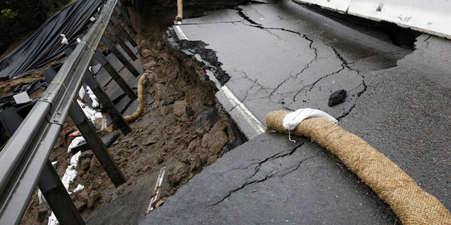 The shoulder and one lane of westbound Highway 50 are damaged due to storms near Pollock Pines, Calif.