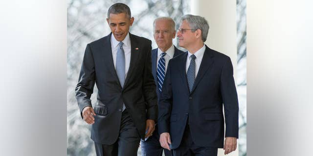 In this photo taken March 16, 2016, Federal appeals court judge Merrick Garland arrives with President Barack Obama and Vice President Joe Biden to be introduced as Obama's nominee for the Supreme Court, during an announcement in the Rose Garden of the White House. Garland is now under consideration to be Biden's attorney general, causing worries by some on the left that it may be difficult to replace him with a GOP-controlled Senate. (AP Photo/Andrew Harnik, File)