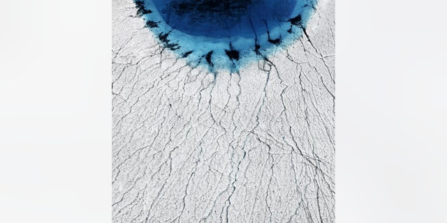 Greenland's lakes are draining away in hours, thanks to a vast network of fissures hidden on the ice sheet below. (Credit: Timo Lieber)