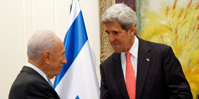 U.S. Secretary of State John Kerry shakes hands with Israeli President Shimon Peres in Jerusalem, Israel, Thursday, May 23, 2013. The US and Israel raised hopes Thursday for a restart of the Middle East peace process, despite little tangible progress so far from Kerry's two-month-old effort to get Israelis and Palestinians back to the negotiating table.  (AP Photo/Jim Young, Pool)