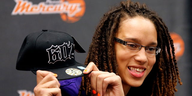 FILEm - In this April 20, 2013 file photo, Phoenix Mercury's Brittney Griner, the No. 1 overall pick the WNBA draft, holds up a hat during a news conference in in Phoenix. Long, athletic, dominating at both ends of the floor, the Mercury's rookie center has the kind of star power that can reach well beyond her 7-foot-4 wingspan. (AP Photo/Matt York, File)