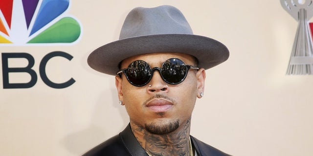 Singer Chris Brown poses at the 2015 iHeartRadio Music Awards in Los Angeles, California, March 29, 2015. REUTERS/Danny Moloshok - RTR4VEB6