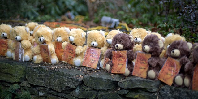 Teddy bears, each representing a victim of the Sandy Hook Elementary School shooting, sit on a wall at a sidewalk memorial Dec. 16, 2012, in Newtown, Conn. A gunman walked into Sandy Hook Elementary School in Newtown Friday and opened fire, killing 26 people, including 20 children.