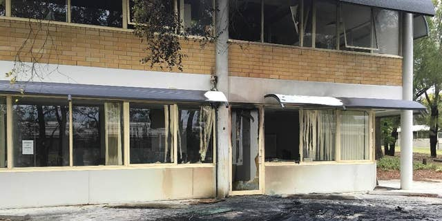 The damaged front of the Canberra office of the Australian Christian Lobby is seen in Canberra, Australia, Thursday, Dec. 22, 2016. A van slammed into the headquarters of a Christian lobbying group in Australia's capital late Wednesday Dec. 21, though it was unclear whether the crash was deliberate, officials said Thursday. (Belinda Merhab/AAP Image via AP)