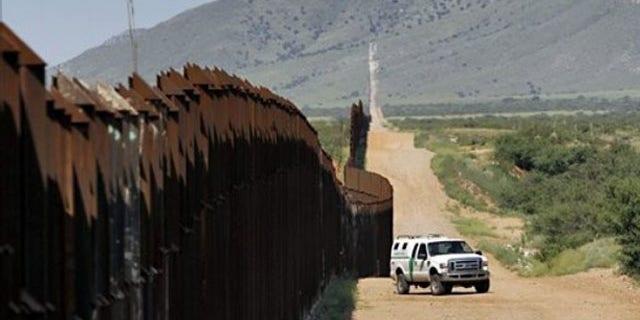 A U.S. Customs and Border Patrol agent patrols along the Arizona-Mexico border Aug. 15 in Hereford, Ariz. (AP Photo)