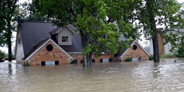 A home surrounded by floodwaters from Harvey on Monday.
