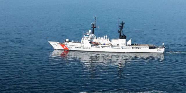 The Coast Guard Cutter Midgett, a 378-foot high-endurance cutter homeported in Seattle, transiting the Strait of Juan de Fuca en route to Seattle.