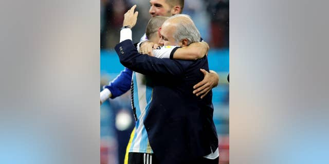 Argentina's head coach Alejandro Sabella, right, hugs Javier Mascherano after Argentina defeated the Netherlands 4-2 in a penalty shootout after a 0-0 tie after extra time to advance to the finals during the World Cup semifinal soccer match between the Netherlands and Argentina at the Itaquerao Stadium in Sao Paulo Brazil, Wednesday, July 9, 2014. (AP Photo/Victor R. Caivano)