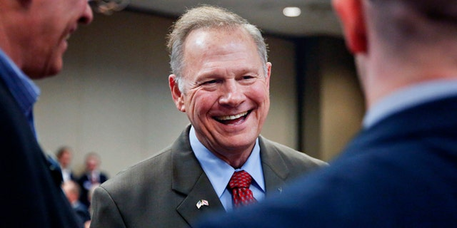 Former Alabama Chief Justice and U.S. Senate candidate Roy Moore, talks to constituents before a Republican Senate candidate forum, Friday, Aug. 4, 2017, in Pelham, Ala. (AP Photo/Brynn Anderson)