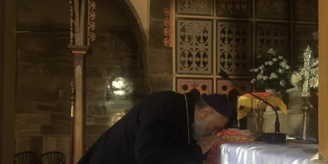Father Afram at St. George Cathedral, outside of Mosul City.