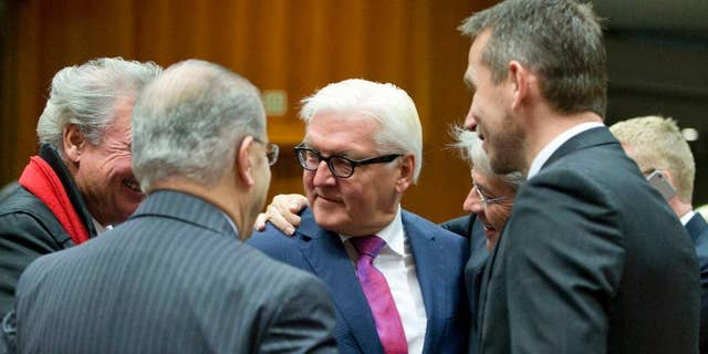 German Foreign Minister Frank-Walter Steinmeier, center, speaks with Danish Foreign Minister Kristian Jensen, right, and Luxembourg's Foreign Minister Jean Asselborn, left, during a meeting of EU foreign ministers at the EU Council building in Brussels on Monday, Nov. 14, 2016. EU foreign ministers meet Monday to discuss strained ties with Turkey and trans-Atlantic ties. (AP Photo/Virginia Mayo)