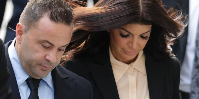 Teresa and Joe Giudice enter sovereign justice in Newark, N.J., for an coming on sovereign swindling and failure rascal charges in 2014.