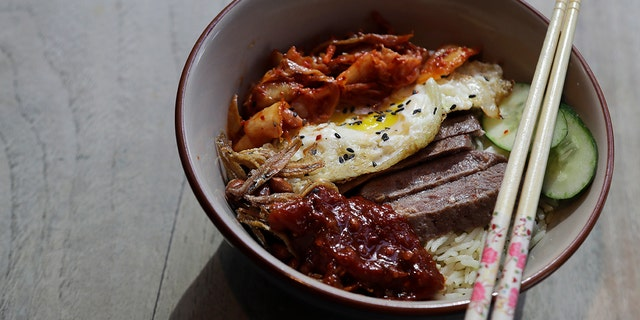 """The """"Trump-Kim Chi Nasi Lemak,"""" a twist on the traditional Nasi Lemak dish, instead comes with U.S. dry-aged beef and a stack of spicy kimchi, a Korean staple."""