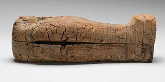The coffin containing the mummified fetus.