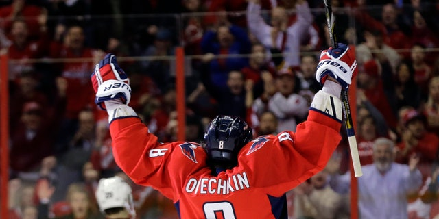 Washington Capitals left wing Alex Ovechkin, from Russia, celebrates after his second goal of the game in the third period of an NHL hockey game against the New Jersey Devils Saturday, Feb. 23, 2013 in Washington. The Capitals won 5-1. (AP Photo/Alex Brandon)
