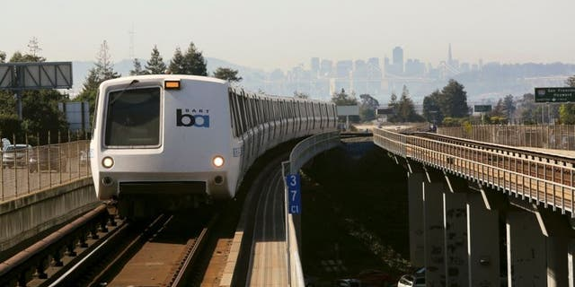 A Bay Area Rapid Transit (BART) train enters the platform area at the Rockridge station in Oakland, California February 12, 2015.  (REUTERS/Robert Galbraith)