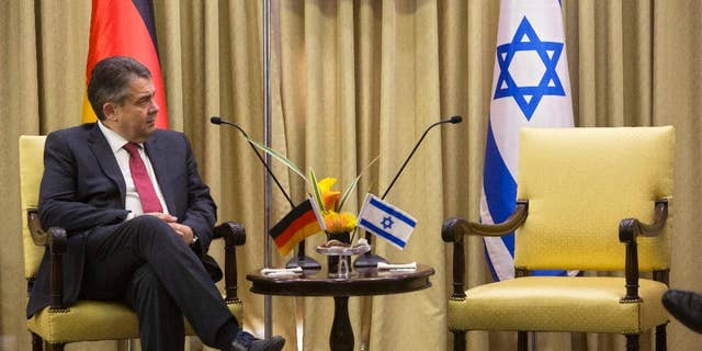 """German Foreign Minister, Sigmar Gabriel looks on during his meeting with Israel's President, Reuven Rivlin at the President's residence in Jerusalem, Tuesday, April 25, 2017. Gabriel said Tuesday it would be """"regrettable"""" if Israeli Prime Minister Benjamin Netanyahu cancels their planned talks in Jerusalem because of his meeting with groups critical of Israel's actions in the West Bank, but downplayed the spat. (AP Photo/Sebastian Scheiner)"""