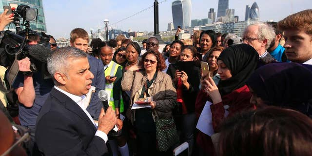 Newly elected London's mayor Sadiq Khan speaks to the media and well wishers outside City Hall in London, on his first day as mayor, Monday May 9, 2016. (Jonathan Brady/PA via AP) UNITED KINGDOM OUT