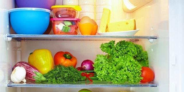 refrigerator full of healthy food. friuts and vegetables