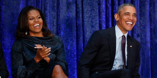 Former U.S. President Barack Obama sits with former first lady Michelle Obama prior during the unveiling of their portraits at the Smithsonian's National Portrait Gallery in Washington, U.S., February 12, 2018.