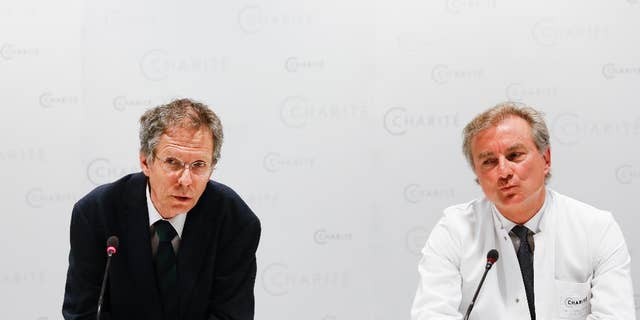 FILE - In this May 27, 2015 file photo Christoph Buehrer, left, director of neonatology at Charite Hospital and Wolfgang Henrich, director of gynecology at Charite Hospital, brief the media about the situation of 65-year old mother Annegret Raunigk and her quadruplets, in Berlin, Germany. Doctors said Wednesday, June 17, 2015 quadruplets born prematurely a month ago to a 65-year-old woman in Germany are doing well and gaining weight but one remains on a respirator.  (AP Photo/Markus Schreiber, file)