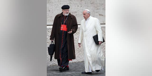 Pope Francis, talks with the head of a sex abuse advisory commission, Cardinal Sean Patrick O'Malley, of Boston, as they arrive for a special consistory in the Synod hall at the Vatican onFeb. 13, 2015.