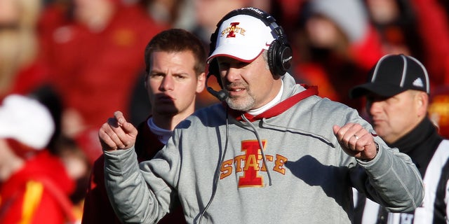 FILE - Iowa State head coach Paul Rhoads directs his players during the first half of an NCAA college football game against West Virginia, in this Nov. 23, 2012 file photo taken in Ames, Iowa. Iowa State might have the best defense no one outside of Ames has heard of this season. The Cyclones held 11 of their 12 opponents below their season scoring average, and half of them at least 10 points under what they normally got.  (AP Photo/Matthew Putney, File)