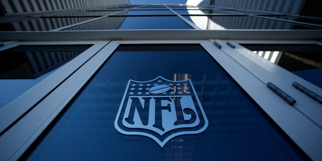 The NFL logo appears on an entrance door to the football stadium at Super Bowl XLII in Glendale, Arizona February 2, 2008. New England Patriots will play the New York Giants in the NFL's Super Bowl XLII football game at the stadium on Sunday.   REUTERS/Mike Blake      (UNITED STATES) - RTR1WL8P