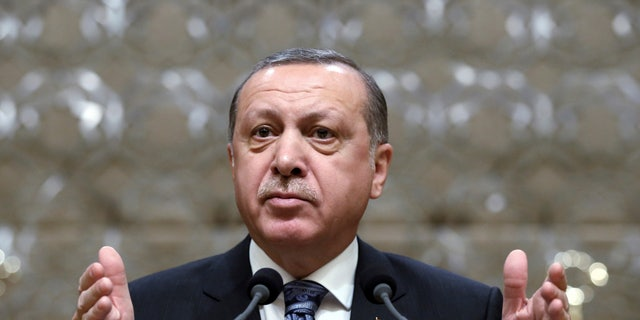 Turkey's President Recep Tayyip Erdogan addresses local administrators at his palace as the parliament continue to debate proposed amendments to the country's constitution that would hand Erdogan's largely ceremonial presidency sweeping executive powers, in Ankara, Turkey, Thursday, Jan. 19, 2017. Legislators on Thursday resume their deliberations on the proposed amendments which last week resulted in brawls between ruling and opposition party lawmakers. (Yasin Bulbul, Presidential Press Service, Pool Photo via AP)