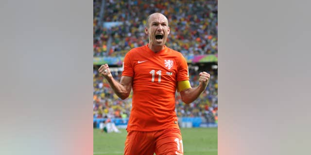 Netherlands' Arjen Robben celebrates after the World Cup round of 16 soccer match between the Netherlands and Mexico at the Arena Castelao in Fortaleza, Brazil, Sunday, June 29, 2014. The Netherlands won the match 2-1. (AP Photo/Wong Maye-E)