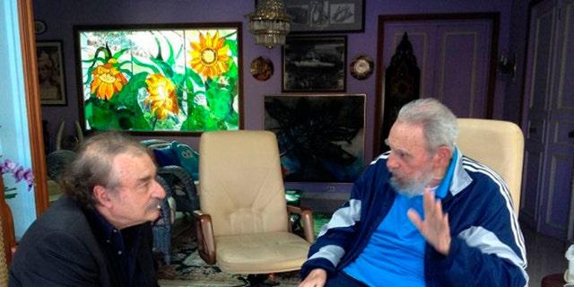 In this Friday, Dec. 13, 2013 photo released by the state media Cubadebate website, Cuban leader Fidel Castro, right, talks with Spanish journalist, writer and former editor-in-chief of Le Monde diplomatique, Ignacio Ramonet in Havana, Cuba. (AP Photo/Granma, Estudios Revolucion)