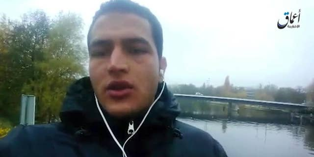 """Dec. 23, 2016: This image made from video released by ISIS, shows Anis Amri, a Tunisian suspect in the Berlin truck attack, pledging allegiance to its leader Abu Bakr al-Baghdadi and vowing to fight against what he calls """"the Crusader pigs."""""""