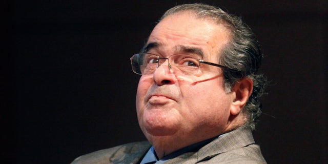FILE - In this Oct. 18, 2011 photo, U.S. Supreme Court Justice Antonin Scalia looks into the balcony before addressing the Chicago-Kent College Law justice in Chicago. (AP Photo/Charles Rex Arbogast)