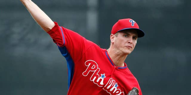 Philadelphia Phillies starting pitcher David Buchanan warms up prior to a spring exhibition baseball game against the Toronto Blue Jays in Dunedin, Fla., Monday, March 24, 2014. (AP Photo/Kathy Willens)