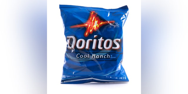 Atlanta, USA - February 11, 2012: A single serving bag of Cool Ranch Doritos. Doritos were the first tortia chip production launched in the United States. Dortiros were introduced by the Frito-Lay company in 1966.
