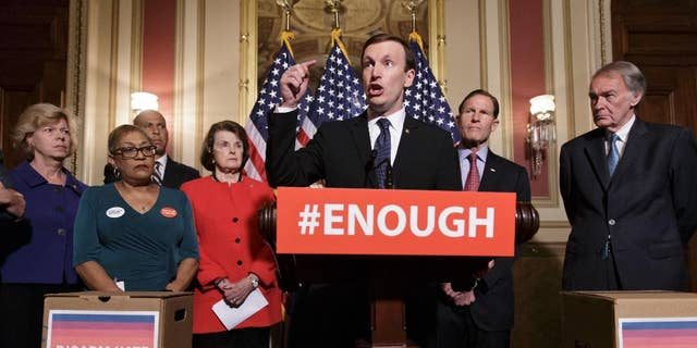 Sen. Chris Murphy, D-Conn., center, calls for gun control legislation in the wake of the mass shooting in an Orlando LGBT nightclub this week, Thursday, June 16, 2016, on Capitol Hill in Washington. From left are, Sen. Tammy Baldwin, D-Wis., Rev. Sharon Risher, Risher, a clinical trauma chaplain in Dallas, who lost her mother Ethel Lance and two cousins in the racially-motivated shooting at the historic Emanuel AME Church in Charleston, N.C. in 2015, Sen. Cory Booker, D-N.J., Sen. Dianne Feinstein, D-Calif., Murphy, Sen. Richard Blumenthal, D-Conn., and Sen. Ed Markey, D-Mass. (AP Photo/J. Scott Applewhite)