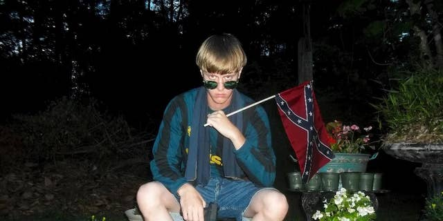 Investigators said Elizabeth Lecron had been exchanging letters with Dylann Roof, seen here, a white supremacist sentenced to death in the killings of nine black worshippers in a racist attack at a South Carolina church.(Lastrhodesian.com via AP, File)