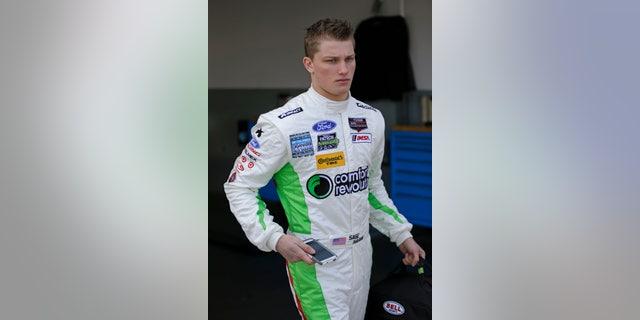 Driver Sage Karam leaves his garage after a practice session for the IMSA Series Rolex 24 hour auto race at Daytona International Speedway in Daytona Beach, Fla., Thursday, Jan. 23, 2014.(AP Photo/John Raoux)