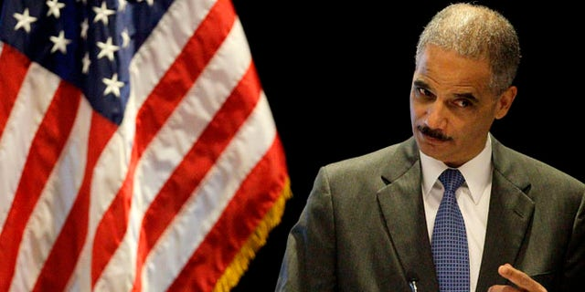 FILE: June 26, 2012: Attorney General Eric Holder gestures while speaking at a civil rights symposium in Boston.