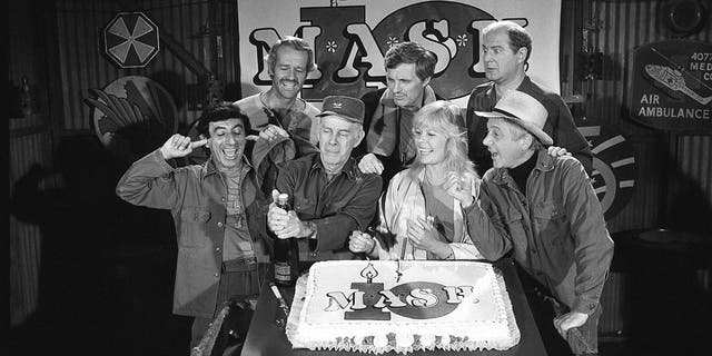 """David Ogden Stiers is seen, top right, with other cast members of TV's """"M*A*S*H,"""" marking the show's 10th anniversary in 1981."""