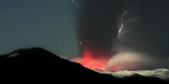June 12: Lightning strikes over the Puyehue-Cordon Caulle volcano in Chile, seen from the international cross border way Cardenal Samore, in southern Chile.