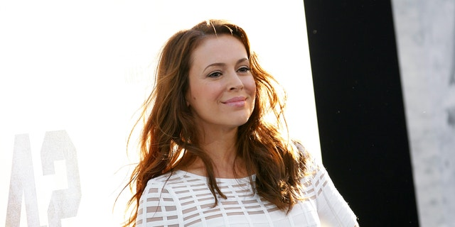 """Actress Alyssa Milano poses at the premiere of """"42"""" in Hollywood, California April 9, 2013."""
