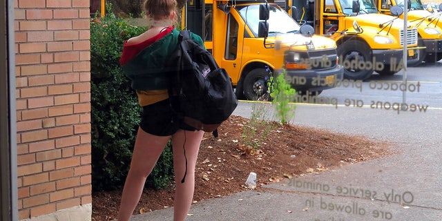 In this Sept. 7, 2018 photo, a student at Grant High School in Portland, Ore., waits for a ride after school.