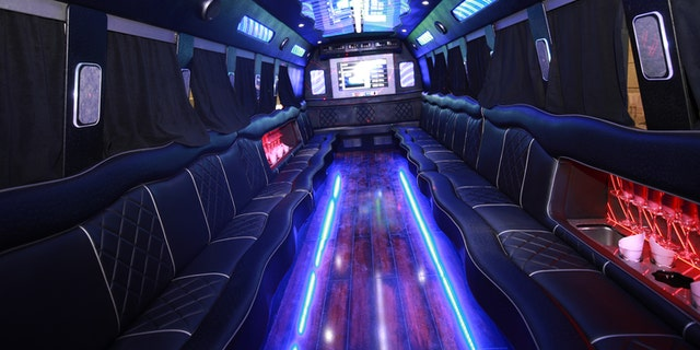 A big party bus filled with comfortable seats, and shiny bright floor for dancing and having fun.