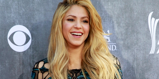 Shakira swapped out her signature blonde hair for a fiery new red color.