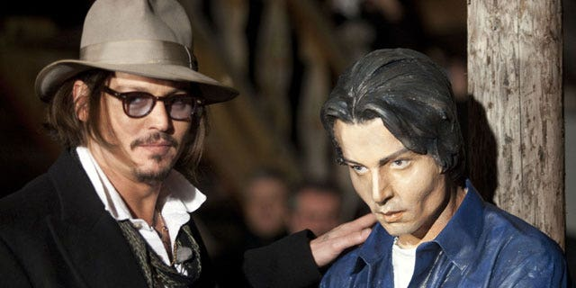 Depp hangs out with a Depp statue in Germany. (Reuters)