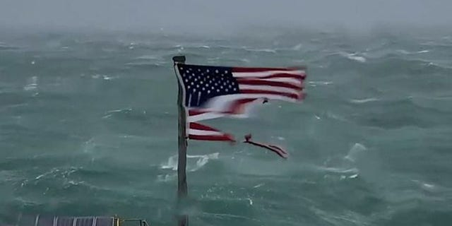 Us Flag Seen Shredded By Hurricane Florence Being
